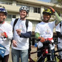 Helping others: Charity cyclists, including John Morris (second from left) and Don Kalubowila (second from right) get ready outside Meisei Gakuen School for the Deaf in Shinagawa Ward, Tokyo, on Friday morning for their eight-day ride to Osaka. | YOSHIAKI MIURA PHOTOS
