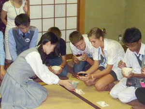 Hands-on: Foreign students learning Japanese take part in a tea ceremony lesson at Toko Gakuen in Kawasaki on Sept. 15, while students from Sri Lanka and Hungary (above) are given lessons in Japanese archery at the school, both as part of a nine-day exchange visit in Japan. | MAMI MARUKO PHOTO