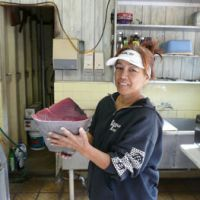 Mouth-watering: Restaurateuse Kanoe Ii at The Fish House in Kawaihae, Hawaii Island, holds a cut of ahi (yellowfin tuna).