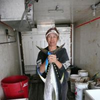 Fine fare: Kanoe Ii holds up a 30 kg ahi (yellowfin tuna) at her restaurant, The Fish House, in Kawaihae, Hawaii Island.