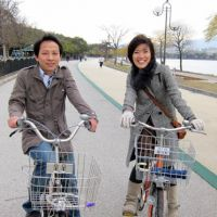 Exercise time: Naoko Yufu (right) and Xie Guosong enjoy riding bicycles at Ohori Park in Fukuoka in December. | NATSUKO FUKUE PHOTO