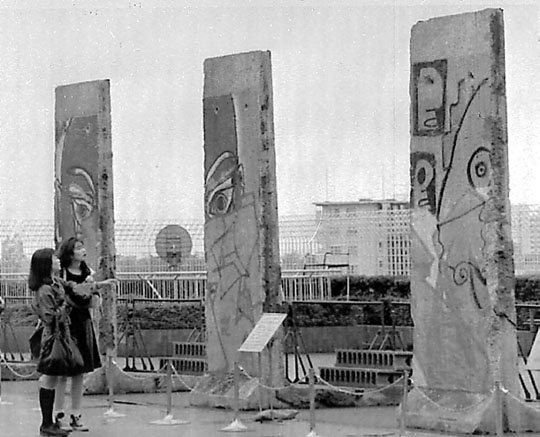 Girls look at parts of the Berlin Wall at an exhibition in Tokyo in 1990. Germany was reunified two months before Hassett arrived in Japan but the Soviet Union still existed. COURTESY OF MICHAEL HASSETT, AP