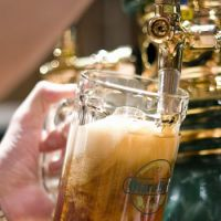 A bar staffer pours a glass of draft Dunkel-type beer at the Soko No. 1 microbrewery in Otaru, Hokkaido.