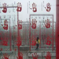 Red-handed: A captivating display in the Anti-Japanese Veterans' Handprints Plaza at the Jianchuan Museum Cluster outside Chengdu commemorates some of those Chinese who fought and survived the conflicts that raged from 1937-45. | JEFF KINGSTON PHOTOS