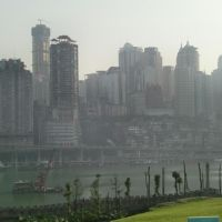 Up, up and away: The soaring skyline of Chongqing is now two hours by rail from Chengdu, not the 12 hours it used to take. However, the grim villages of smoky hovels passed en route underscore China's immense urban/rural divide. | JEFF KINGSTON PHOTOS