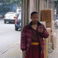 Sutra messaging: A monk in Chengdu's raffishly charming Tibetan quarter, where many shops sell religious paraphernalia, jewelry and yak-butter-tea blenders.