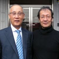 Shinji Takahashi (left), who leads a campaign to achieve UNESCO World Heritage status for the Tomioka Silk Mill, poses with film director Masamoto Sakurai. | ANGELA JEFFS