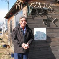 Making it pay: Chiharu Tezuka stands by the shed from where he sells the rice and other produce from his large farm. His rice-processing plant is also a key part of his business model.