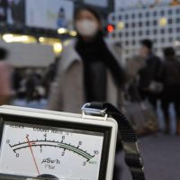 Should I stay or should I go?: A Geiger counter shows above-normal levels of radiation on March 15 in Shibuya, Tokyo. Since the spike last Tuesday, radiation levels have almost consistently been under the worldwide average in the capital. | KYODO PHOTO
