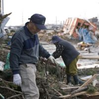 Where to start?: Isamu Higuchi and his wife, Rie, pick through the remains of their home in Sendai, Miyagi Prefecture, that was smashed to bits by the March 11 tsunami. | ROB GILHOOLY PHOTO