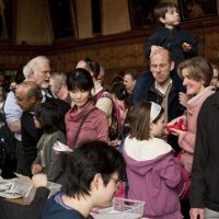 People gather at a fundraising event held March 27 in Oxford, England to support victims of the massive earthquake and tsunami that hit northeastern Japan. | SKYE HOHMANN