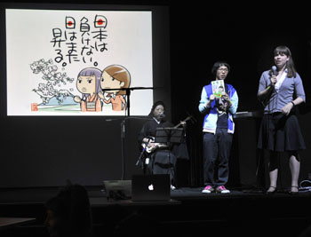 A group of manga artists give an explanation about their project to auction original prints of their cartoons during the 'PechaKucha &#8212; Inspire Japan' event Saturday night. | YOSHIAKI MIURA PHOTOS