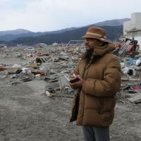 Rajib Shaw inspects a tsunami-ravaged area of Rikuzentakata, Iwate Prefecture, during his visit to Tohoku in early April. | COURTESY OF IEDM, KYOTO UNIVERSITY
