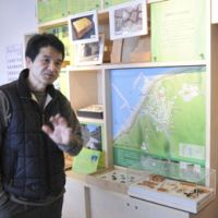 History at his fingertips: Mikura Island tourist center staffer Setsuyoshi Hirose