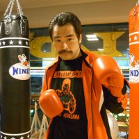 Boxer Yoshinori Nishizawa poses for the camera before teaching his class at Gold's Gym in Tokyo's Nakano. | BARBARA BAYER PHOTO