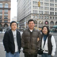 Scott and his parents, Sung and Giyeon Kang, pose for a picture in New York in late 2009.