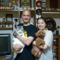 Close friends: Kim and Junko Knudsen pose with their cat, Kogoro, and dog, Tuffy, at their home in Nerima Ward, Tokyo. | MAMI MARUKO PHOTO