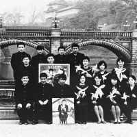 Members of Tenjo Sajiki (above left), a theater group founded by Shuji Terayama (right in the back row) in front of Nijubashi Bridge in Tokyo's Chiyoda Ward in 1967. Yokoo is third from the left in the front row.
