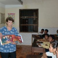Heather Willson interacts with students at the Butterfly school in Cambodia during a visit in March. | COURTESY OF HEATHER WILLSON