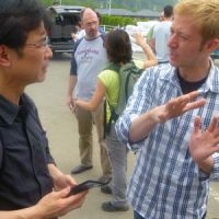 Tatsuya Yoshioka (left) and Charles Lent discuss the possibility of logistics corporations providing expertise for the relief effort's warehousing operations in Ishinomaki. | DEUX RICHARD PHOTO