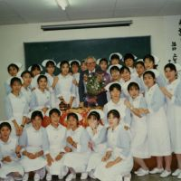 Votes of thanks: Alfons Deeken (left) with students to whom he taught a course on death and dying at the Japanese Red Cross Society's nursing school in Tokyo around 1988.