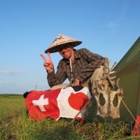 Thomas Kohler poses beside his tent in Teshio, northern Hokkaido on Aug. 4 during his trek along the Sea of Japan coast. | COURTESY OF THOMAS KOHLER
