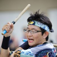 Tomoko Igarashi, who has been teaching taiko drumming for the last 14 years, poses with her students during a lesson held last month at the British School in Tokyo. | COURTESY OF MIYABI ARASHI TAIKO SCHOOL, GIANNI SIMONE
