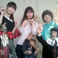 Play school: Students in Jesse Glass' English literature class at Meikai University hold puppets of the Devil King (left), the Fiddling Devil (center) and Faustus, which they use to present their professor's original work, 'Faustus and the Golden Keitai.' | DAVID F. HOENIGMAN PHOTO