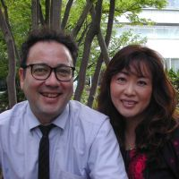 Two of a kind: Mike and Yuka Rogers pose outside a cafe in Setagaya Ward, Tokyo. | MAMI MARUKO PHOTO