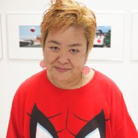 Okinawa-based photographer Mao Ishikawa at her gallery in the city of Okinawa. | COURTESY OF MAO ISHIKAWA, JON MITCHELL