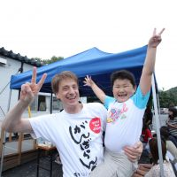 Distributing good vibes: Vincent Marx, a member of the Ganbaranba volunteer group, gives a 'free hug' to a boy in Ofunato, Iwate Prefecture, during an event in September to cheer up tsunami survivors. | COURTESY OF TAKAYUKI SATO