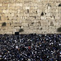 Jewish men opposed to a U.S.-sponsored Mideast peace summit pray at the Western Wall in Jerusalem, Judaism's holiest site, on Nov. 26, 2007. | AP PHOTO