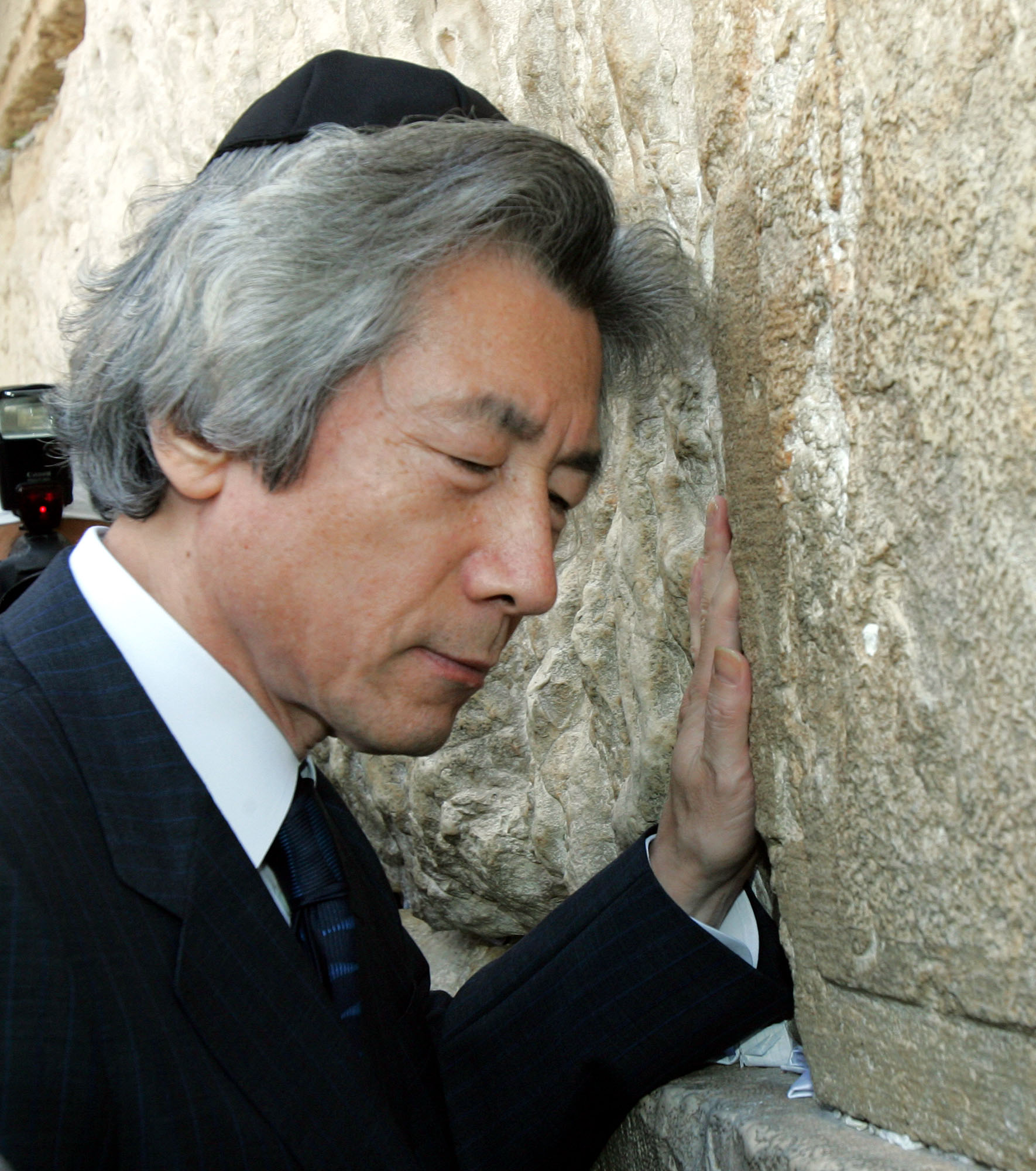 If walls could talk: Then Prime Minister Junichiro Koizumi visits the Western Wall in Jerusalem in 2006. Japan and Israel are both islands (Japan literally, Israel due to conflict with its neighbors), but the effect of this isolation on each country's people has been very different, with Japanese increasingly turning inward while Israelis opt to break out of the Middle East the first chance they get. | AP PHOTO