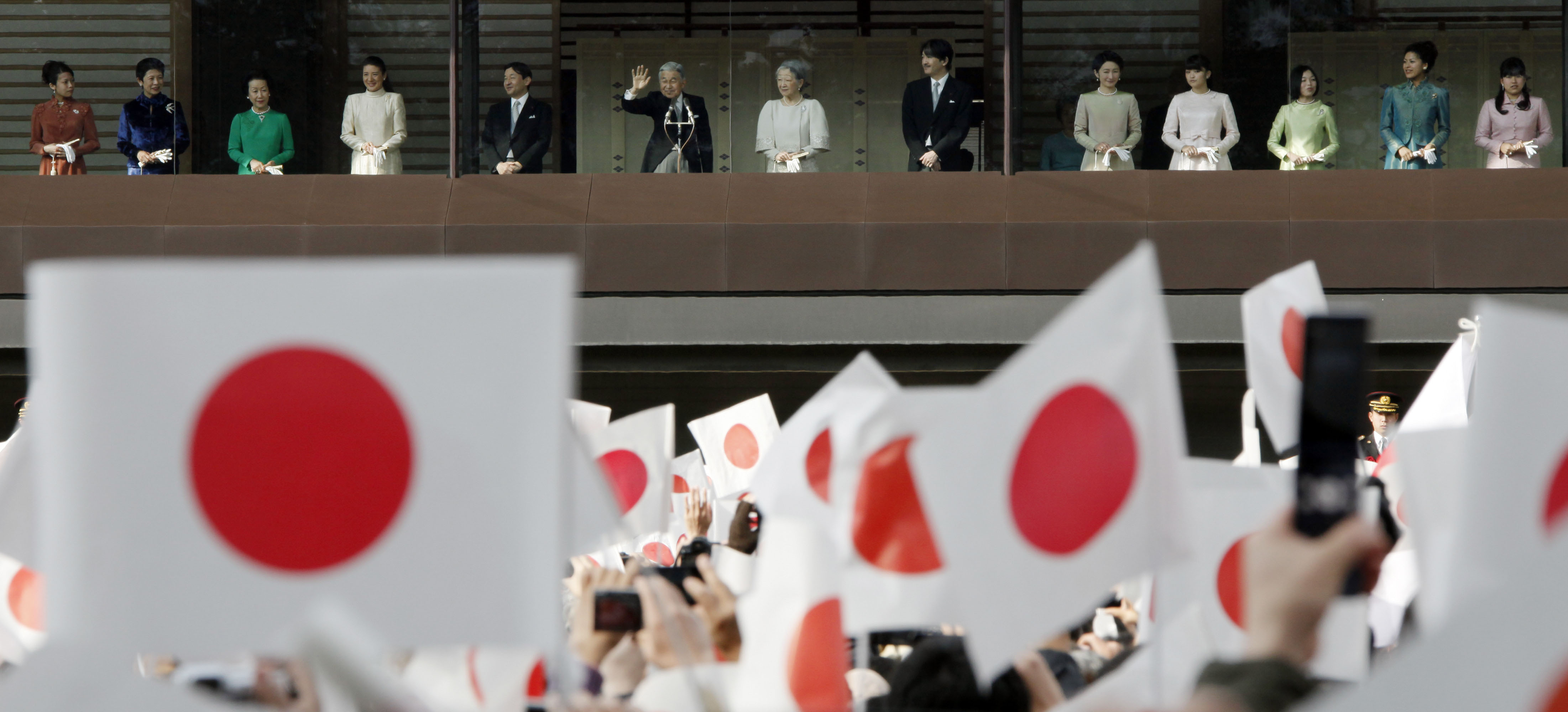 Ever-decreasing circles: Emperor Akihito, flanked by other members of the Imperial family, waves to well-wishers from the balcony during a New Year's public appearance at the Imperial Palace in Tokyo on Jan. 2. | AP