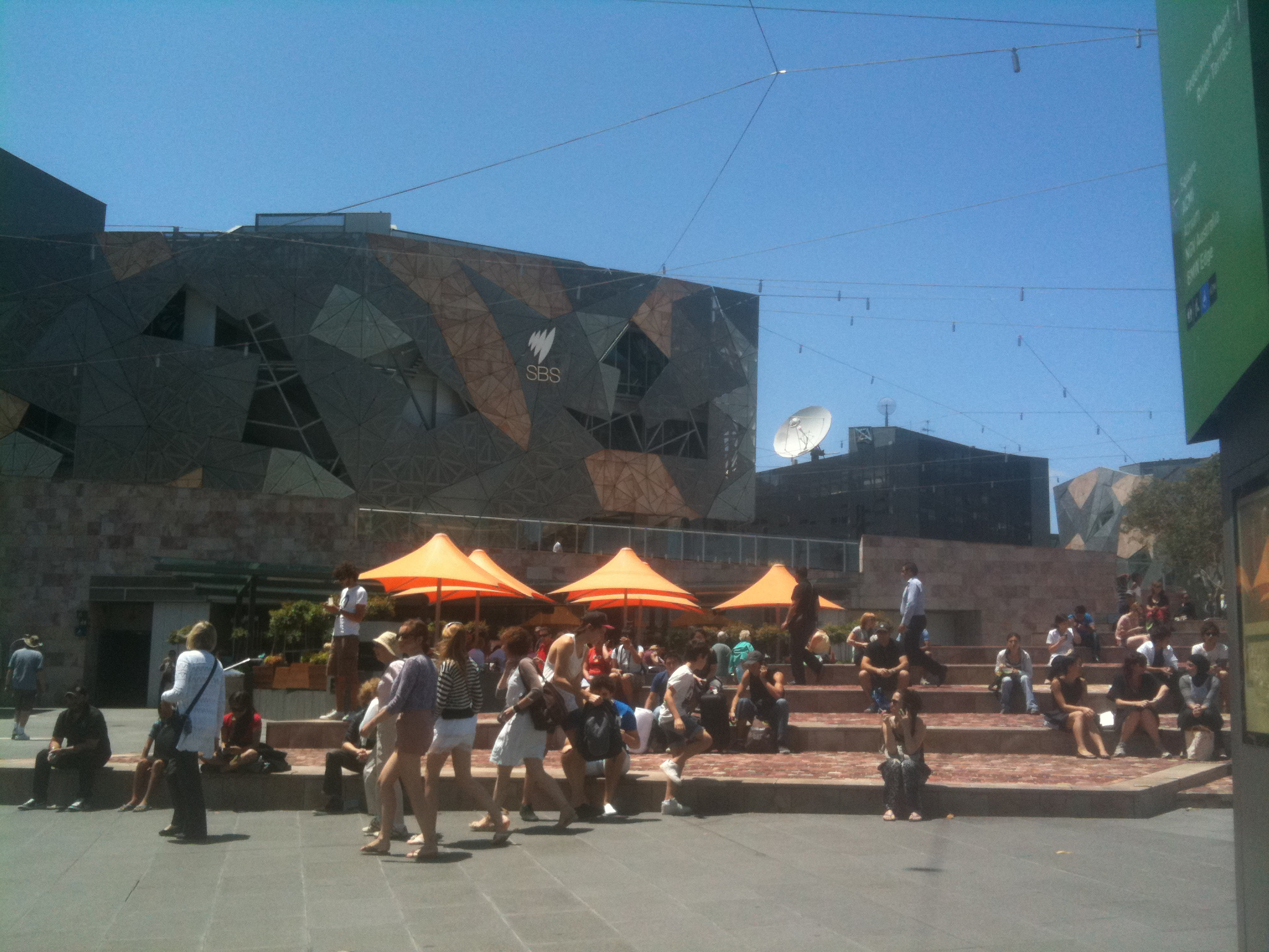 The Federation Square in Melbourne, Australia uses fake grass in places. | AMY CHAVEZ