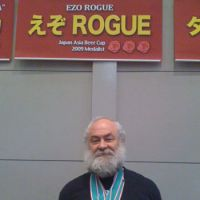 Kaufman wears some of the many awards Rogue, one of U.S. craft beers he introduced to Japan, has won over the years at various craft beer competitions.