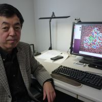 Digital health: Professor Hideaki Fujitani, a bio-computing expert at the University of Tokyo, shows an all-atom simulation video used in drug development. | TOMOKO OTAKE