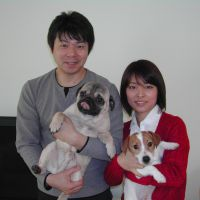 Extended family: Hiroshi and Ying Kato are seen with their two dogs, Ton Ton and Ken Ken, at their home in Kawasaki. | MAMI MARUKO PHOTO