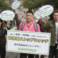 Taro Yamamoto on Feb. 24, 2012, lobbying outside the Fukui Prefectural Assembly. | KYODO