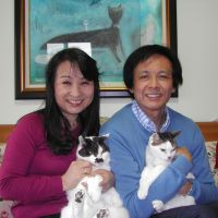 Pet therapy: Dale and Shoko Araki relax with their cats Suki and Yaki at their home in Kawasaki. | MAMI MARUKO