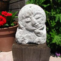 Matsuura has learned carving o-jizo statues from a local master.