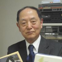 World literature: Academic and Akutagawa expert Yasuyoshi Sekiguchi holds copies of the author's works translated into English (left) and Korean. | ERIKO ARITA