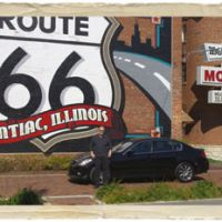 Following the signs: Soon after setting out, the author stands beside the 3.7-liter Infiniti sports sedan in which he and a friend traced the old Route 66 in fine style. | MARK SCHREIBER