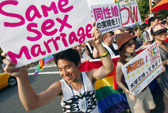 On again, off again: Gay and lesbian rights activists demonstrate at the Tokyo Pride Parade in August 2007 in Yoyogi Park. | AP