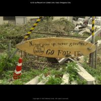 Timely advice: This message written on a surfboard was photographed by filmmaker Michael Arias in Tohoku following the March 11, 2011, tsunami that devastated parts of the region. The work was recently shown at a Japan film festival in Frankfurt, Germany. | MICHAEL ARIAS