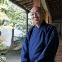 Shinsho Kajita, head monk of the Honen-in Temple in Kyoto, has opened the temple's doors wide to the public through concerts, art exhibitions and symposiums. Below: Cellist Mari Fujiwara performs at one such event held last Sunday at the temple. | JANE SINGER, COURTESY OF SHINSHO KAJITA
