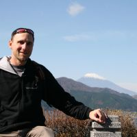 Gardner Robinson poses in Hakone, Kanagawa Prefecture, with Mount Fuji in the background. | COURTESY OF GARDNER ROBINSON