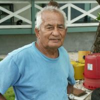 Where 79-year-old Joe de Brum runs a guesthouse. Meanwhile, with a storm brewing, fishermen sail off from Majuro in an outrigger. | CHRISTOPHER JOHNSON