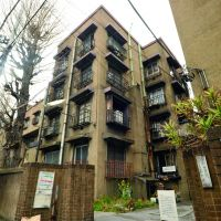 Fond farewell: The steel-and-concrete Uenoshita Apartments building in Tokyo's Ueno district (above) is the last of the Dojunkai complexes that were built in the aftermath of 1923's Great Kanto Earthquake. The few remaining occupants, including Helmut Rudolph, are gradually moving out as the apartments are sold to developers. When all are sold, the building will be demolished. | YOSHIAKI MIURA PHOTOS
