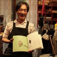Storied: Akira Kuroiwa shows his work in 'Where Netsuke Carver Skills Meet those of a Jeweler,' a book about him published by Kyoto Seishu Netsuke Museum. | JULIAN LITTLER